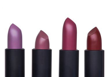 Exclusive and expensive lipsticks in a black tubes on a white background. Fashionable colors of the season
