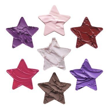 Set of stencils in the shape of five-pointed stars isolated on white background. Texture of a lipstick or face cream is made in the shape of a of five-pointed stars stencil