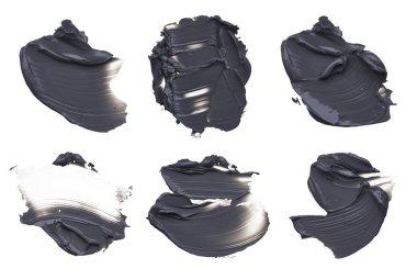 Set of black smears of face mud mask on white background