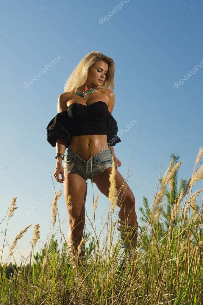 Country fashionable girl in the summer forest
