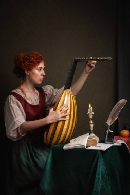 Red-haired girl in a historical suit plays the lute. Renaissance painting style