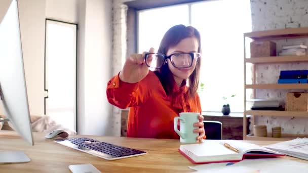 Businesswoman putting on glassses.