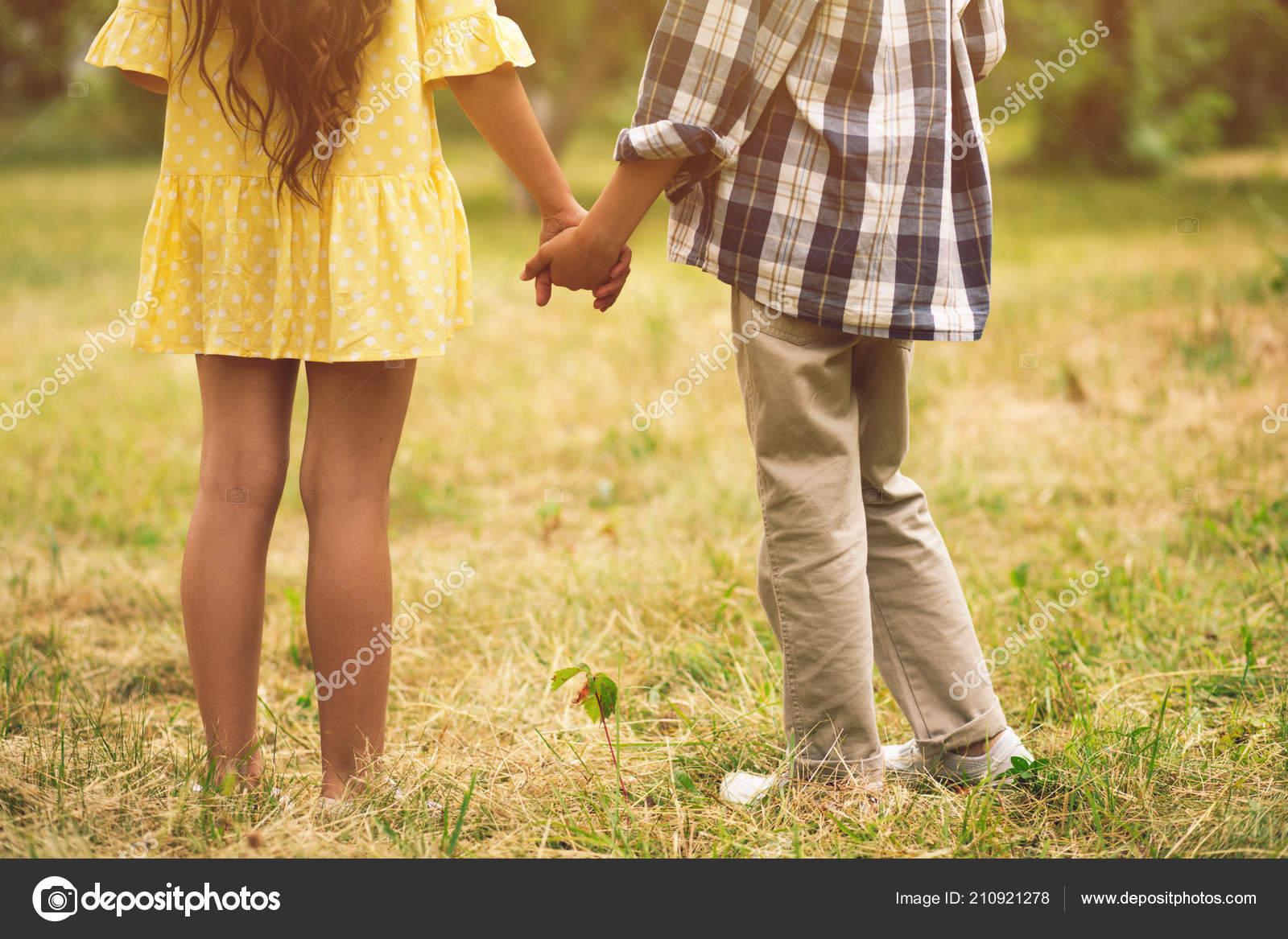 Boy And Girl Holding Hands Stock Photo Svyatoslavlipik 210921278