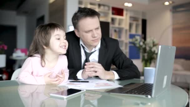 Daughter helping father working at home