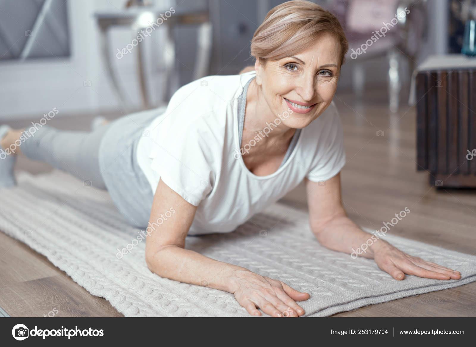 Yoga Classes At Home Beautiful Women Over 50 Years Stock Photo C Svyatoslavlipik 253179704
