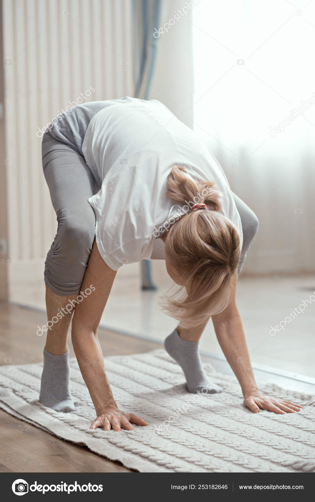 Pictures Women Over 50 European Looking Woman Over 50 Years Old Doing Yoga At Home In The Living Room Stock Photo C Svyatoslavlipik 253182646