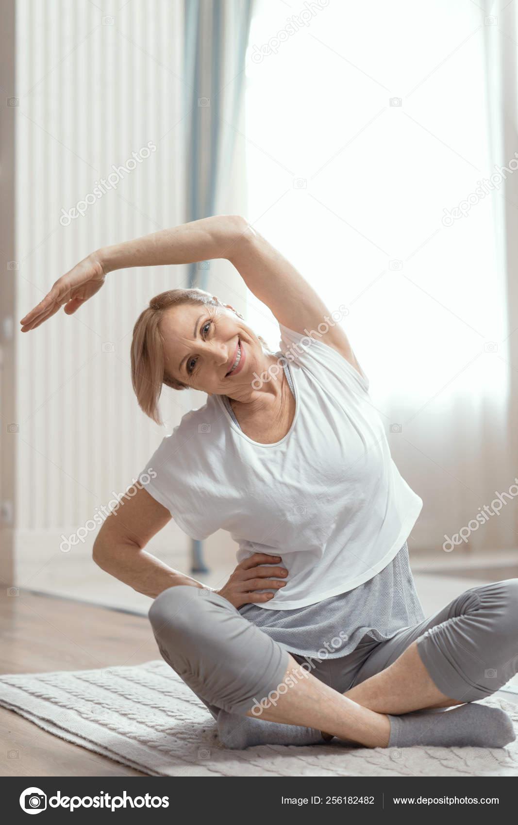 Yoga Classes At Home Beautiful Women Over 50 Years Stock Photo C Svyatoslavlipik 256182482