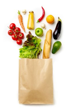 Photo of paper bag with vegetables, juice, orange