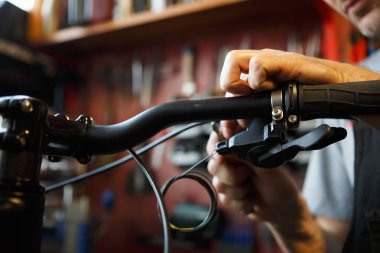 Photo of man holding bicycle repair