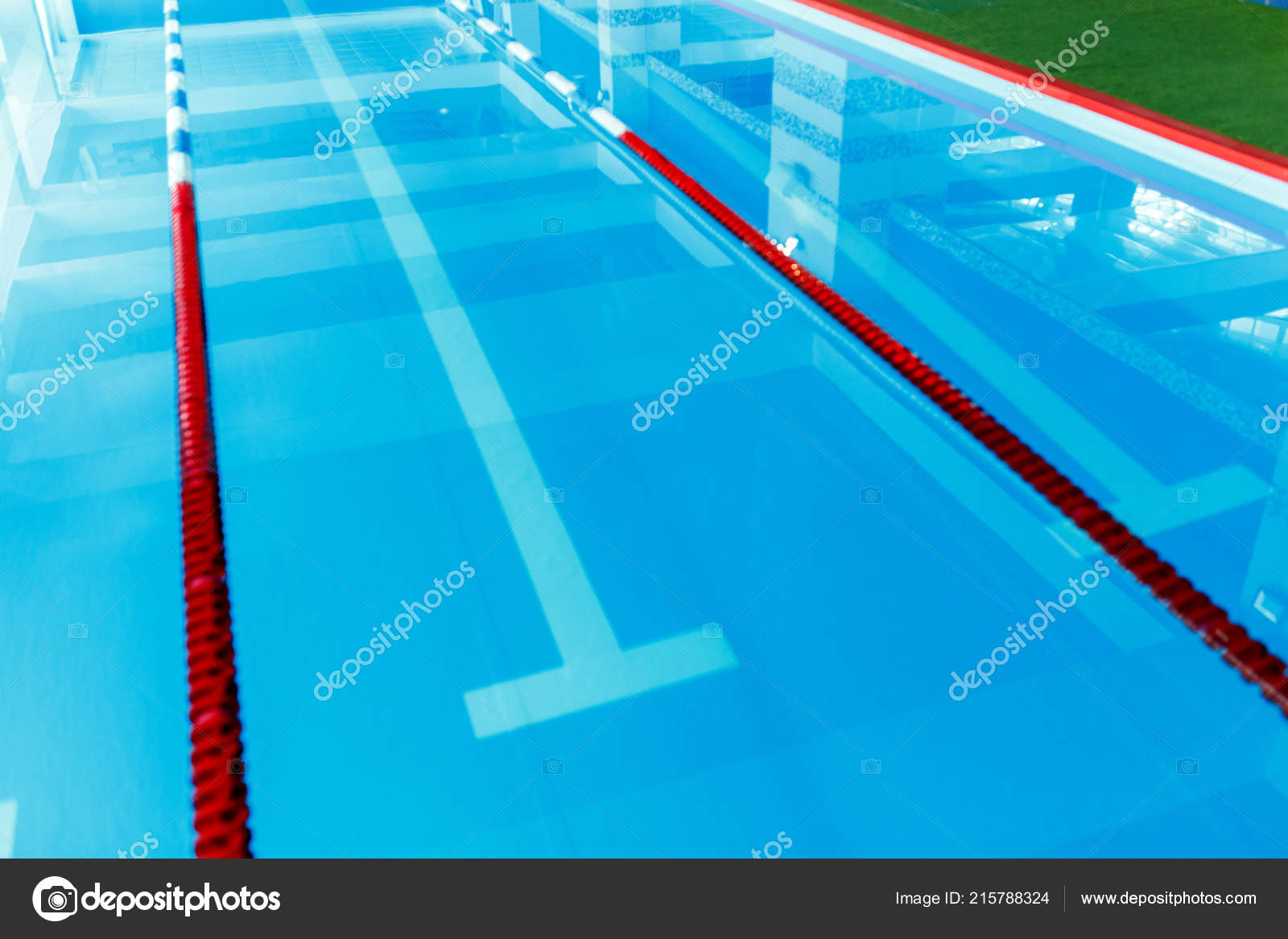Picture from top of swimming pool with blue and white, red ...