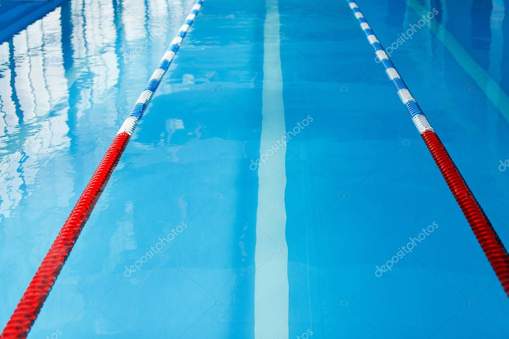 Image from top of swimming pool with red dividers without people