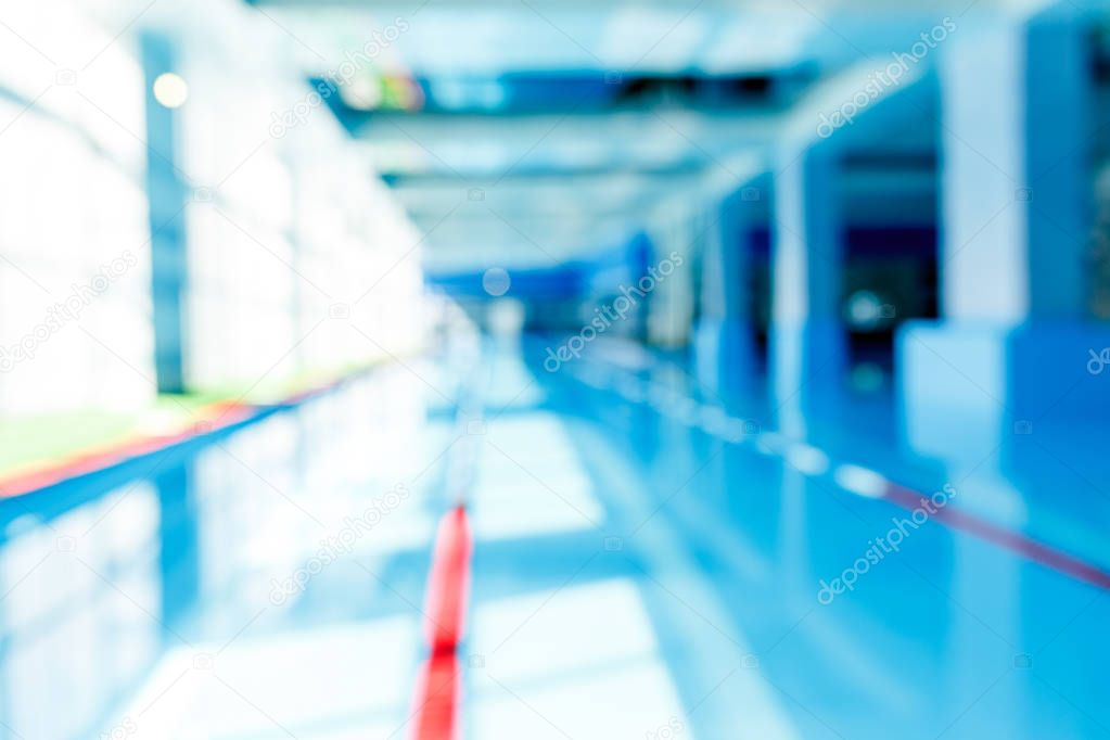 Defocused photo of swimming pool with red dividers