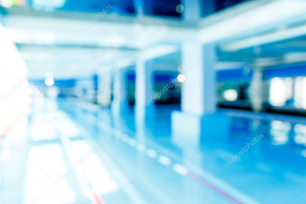 Defocused image of swimming pool with red dividers