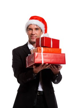 Photo of cheerful brunet in business suit, santa hat with gifts in boxes
