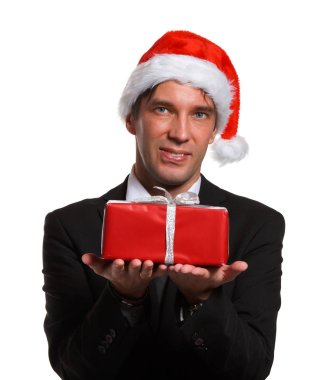 Portrait of man in business suit, Santa cap with gifts in box