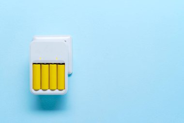 Image of charger with yellow batteries