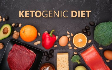 Ketogenic diet concept.Photo of food products on black stone table in studio.