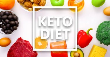 Image on top of piece of meat, fish, cheese, eggs, vegetables, fruits, olives, walnuts on white background.Ingredients for ketogenic diet.
