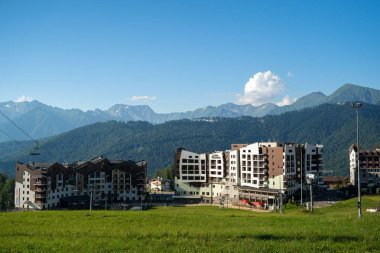 Russia, Sochi - July 4, 2019: Cable car, view on hotels Rosa Chalet on summer day. Krasnaya Polyana at summer day stock vector