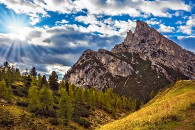 Last sunny autumn day. Travel in the Dolomites. Falzarego pass. The concept of active and adventure tourism