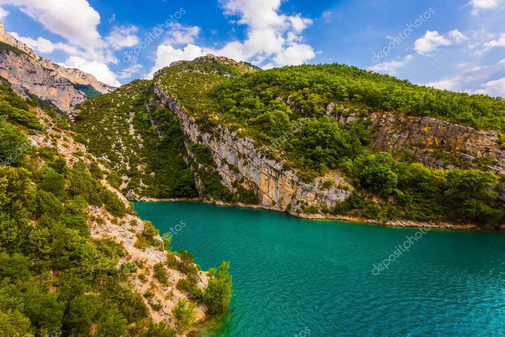 The Provence Alps, France. Fascinating journey along the mountain river. The Verdon River flow between the sheer cliffs of Verdon Canyon.