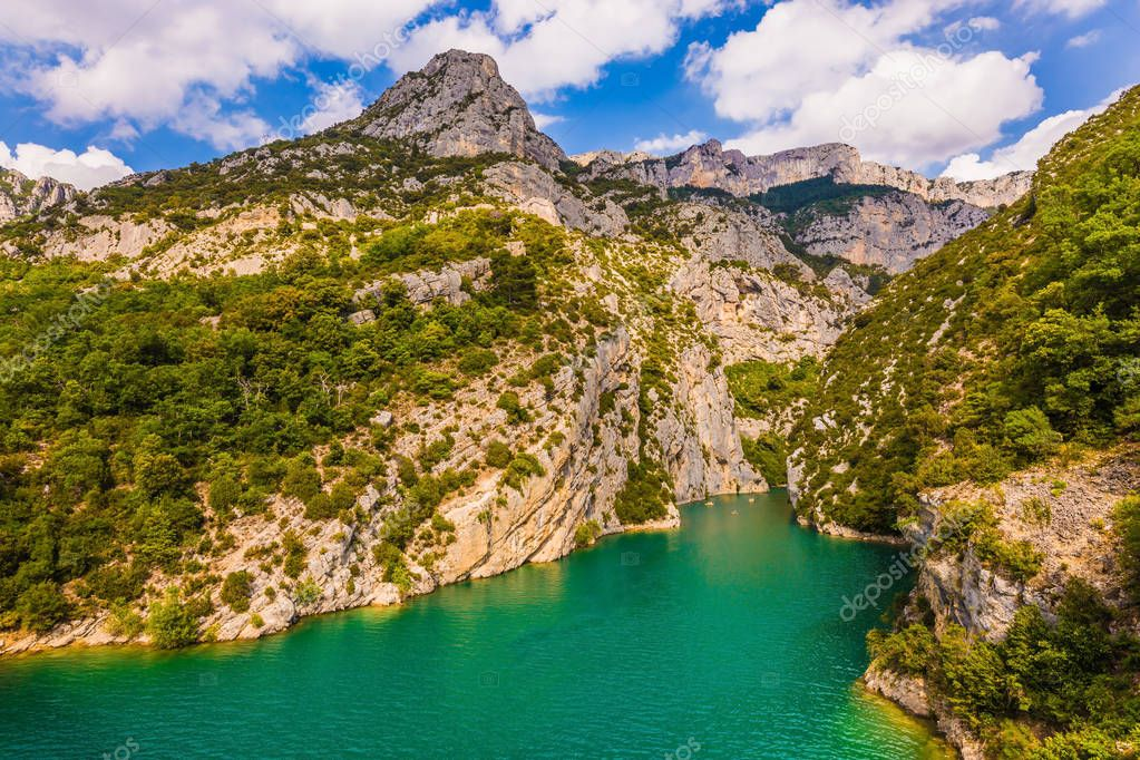 The Provence Alps. The Verdon River flow between the cliffs of Verdon Canyon, France. The journey along the mountain river on catamarans. Concept of ecological and active tourism