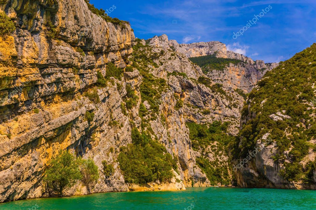 Fascinating journey through azure waters of Verdon River, Provence Alps, France. River flowing between sheer cliffs of Verdon Canyon. Concept of ecological and active tourism