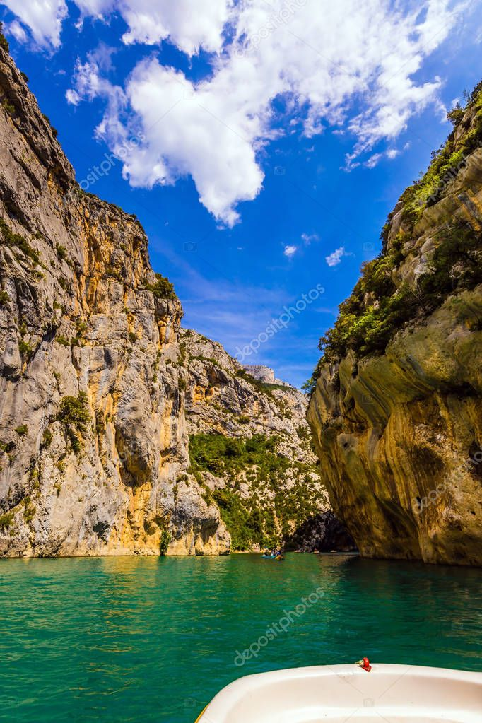 Walking by water bike along green waters of Verdon River in Mercantour Park, Provence Alps, France
