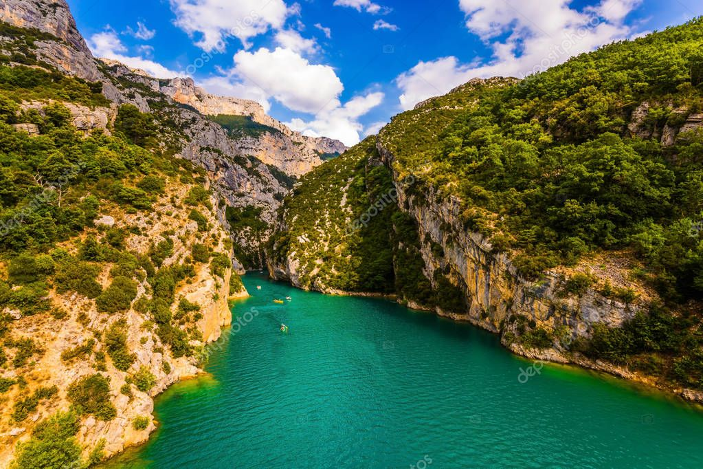 The Provence Alps. Fascinating journey along the mountain river on catamarans. The Verdon River flow between the sheer cliffs of Verdon Canyon, France. Concept of ecological and active tourism