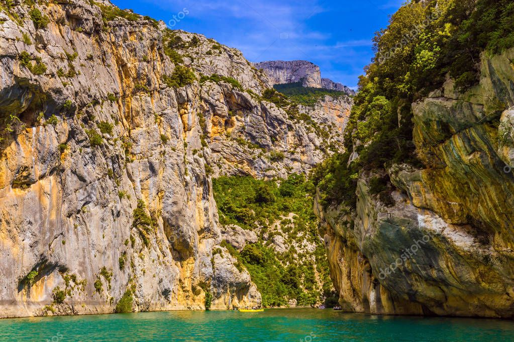 Fascinating journey through the azure waters. The river flow between the sheer cliffs of Verdon Canyon. The Verdon River, Provence Alps, France. Concept of ecological and active tourism