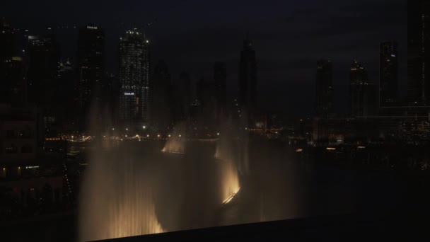 Dubai Fountain is the worlds largest choreographed fountain system on the Burj Khalifa Lake at night stock footage video