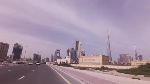 Car trip on the roads of Downtown with skyscrapers in Dubai