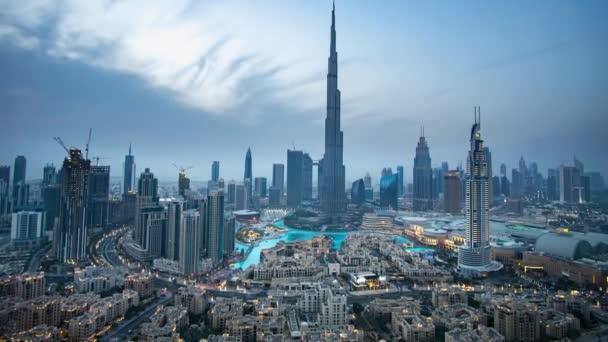 Burj Khalifa and Dubai Fountain against the sunset Time-lapse stock footage video
