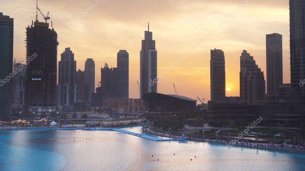 Modern architecture Downtown Dubai around the Burj Khalifa Lake at sunset
