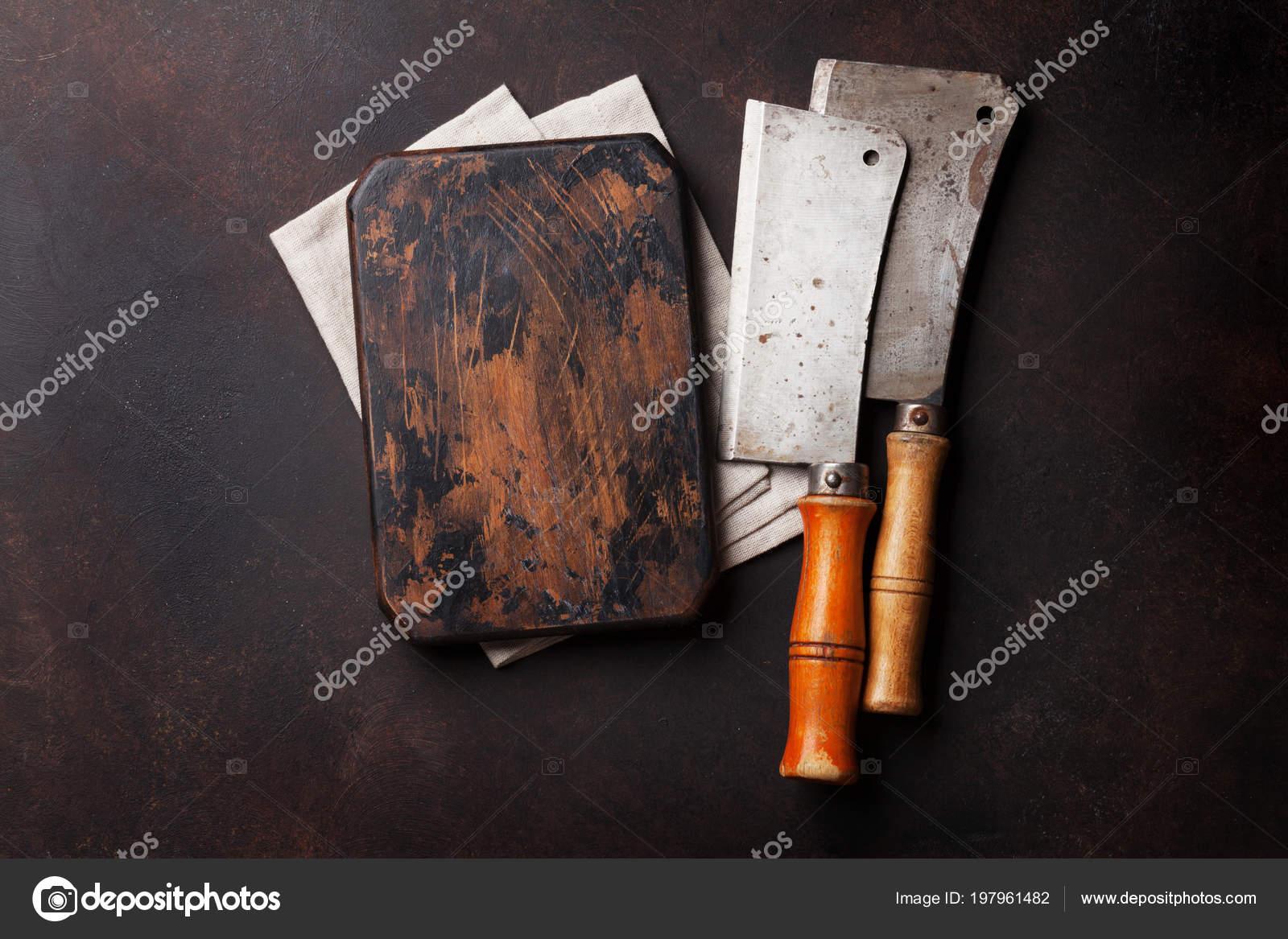 boucher vintage viande couteaux planche découper par dessus bord