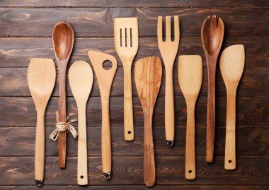 Various cooking utensils over wooden kitchen table. Top view