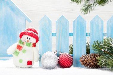 Christmas snowman toys, baubles and fir tree branch. Xmas decor