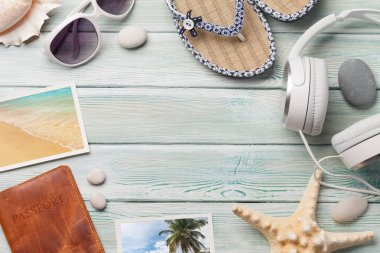 Travel vacation and music concept with headphones, sunglasses, seashells and photos on wooden backdrop. Top view with copy space. Flat lay. All photos taken by me