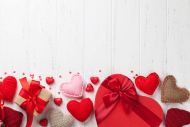 Valentine's day greeting card with handmaded heart toys and love gift boxes on wooden background. Top view with space for your greetings. Flat lay stock vector