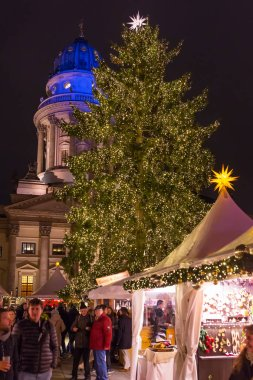 BERLIN, GERMANY - DECEMBER 6TH, 2017: Decorated booths and Christmas lights at Gendarmenmarkt Christmas Market.