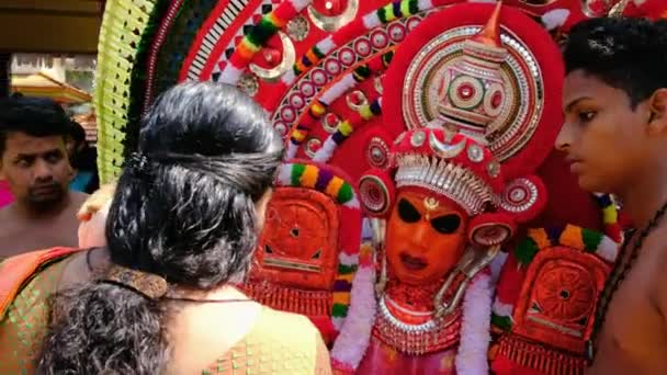 Theyyam perform during temple festival in Payyanur, Kerala, India
