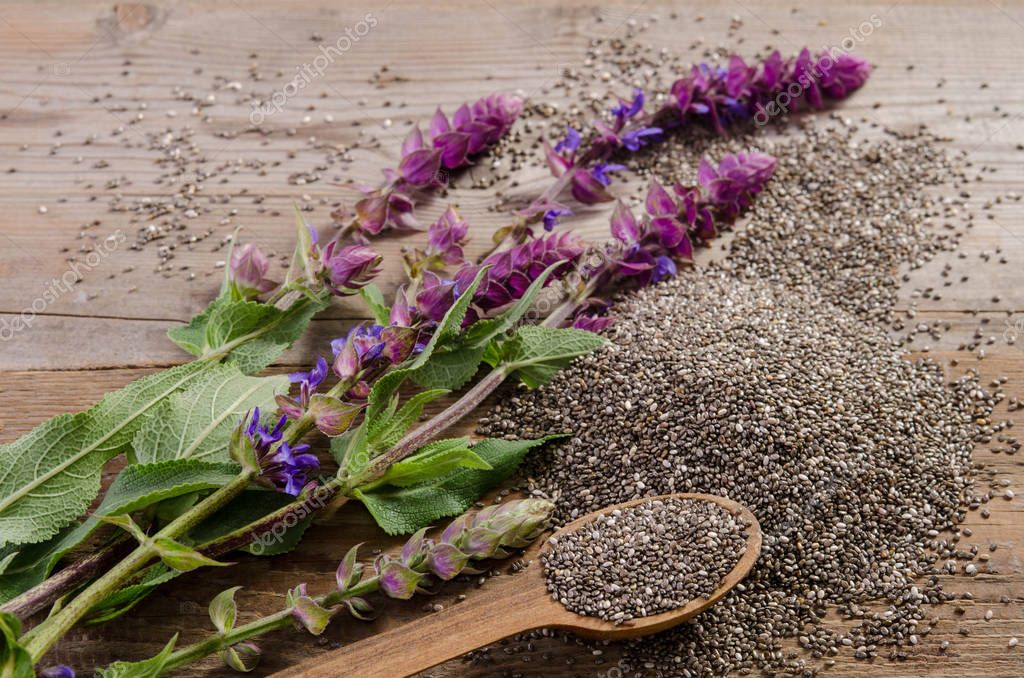 Chia seeds healthy superfood with flower on wooden table