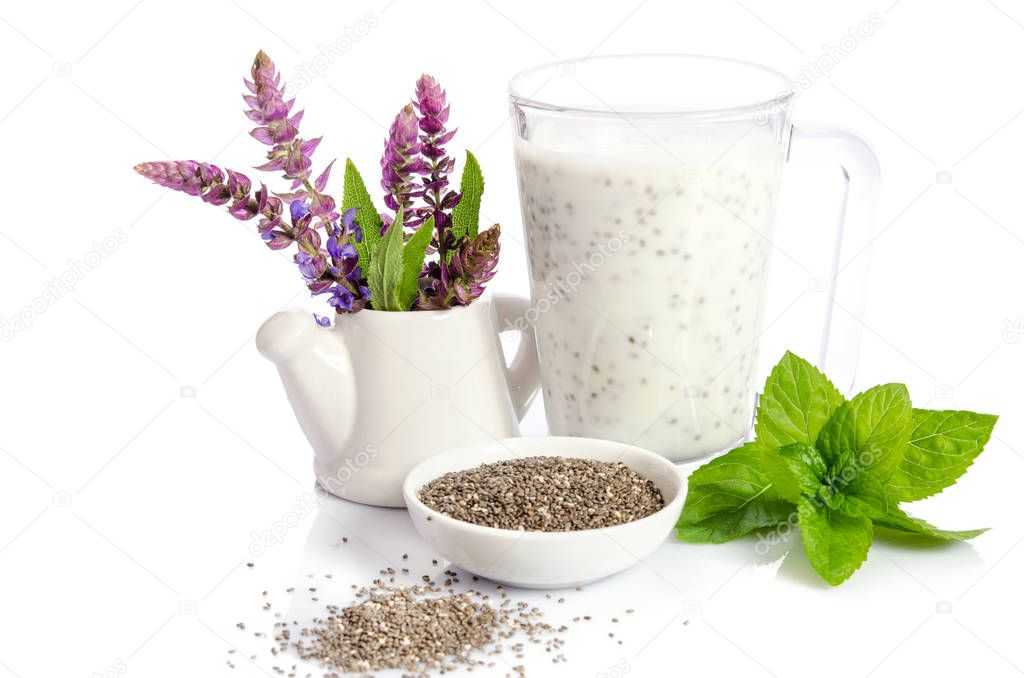 healthy breakfast : yogurt with chea seeds, mint leaves and  salvia flowers isolated on white
