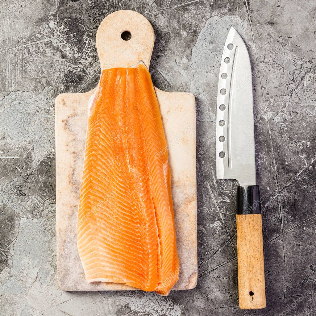 Raw salmon filet and ingredients