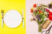 Fotografie Flat lay of Wild flower bouquet and white plate on pastel color background