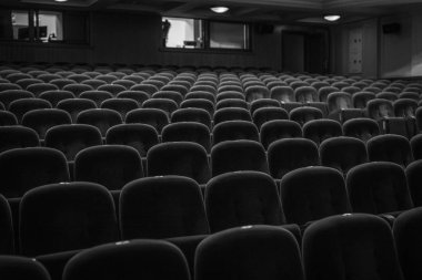 Classic armchairs of old theater. Black-white photo.