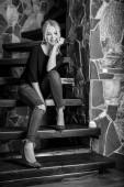 Fotografie Young beauty woman against house interior. Black-white portrait.