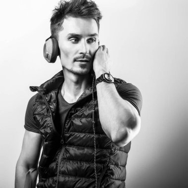 Young handsome man listening music. Black-white photo.