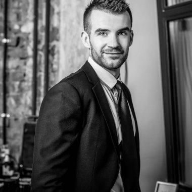 Elegant young man in barbershop. Black-white photo. stock vector