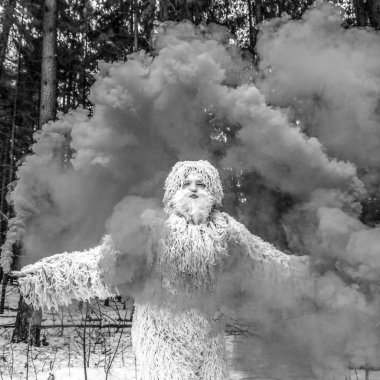 Yeti fairy tale character in winter forest. Outdoor fantasy black-white photo.